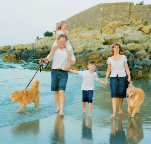 A Family Walk At The Beach